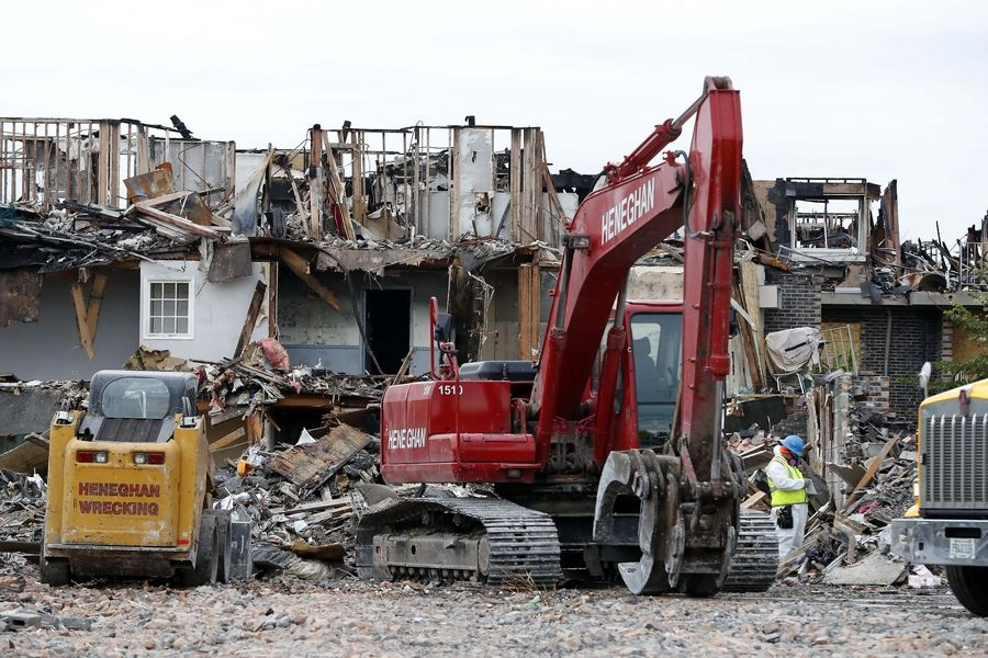 Four connected buildings with 96 units and the contents in them were damaged in a massive fire at the River Trails condominium complex in Prospect Heights in July. Demolition of three of the four buildings continued Friday. Three new structures will be constructed, with renovations to the fourth.