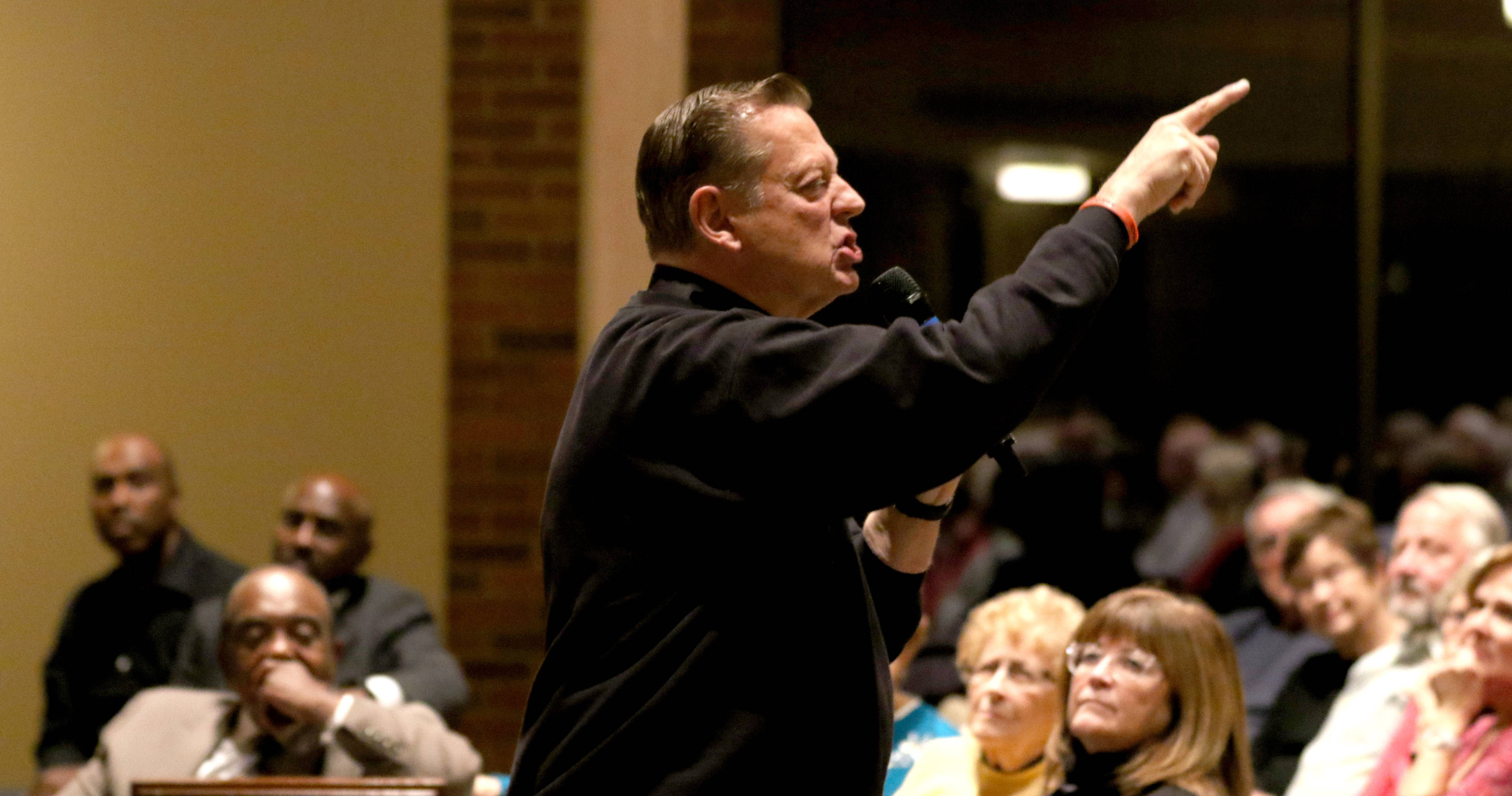 Father Pfleger at Arlington Heights church: Get off the sidelines and help