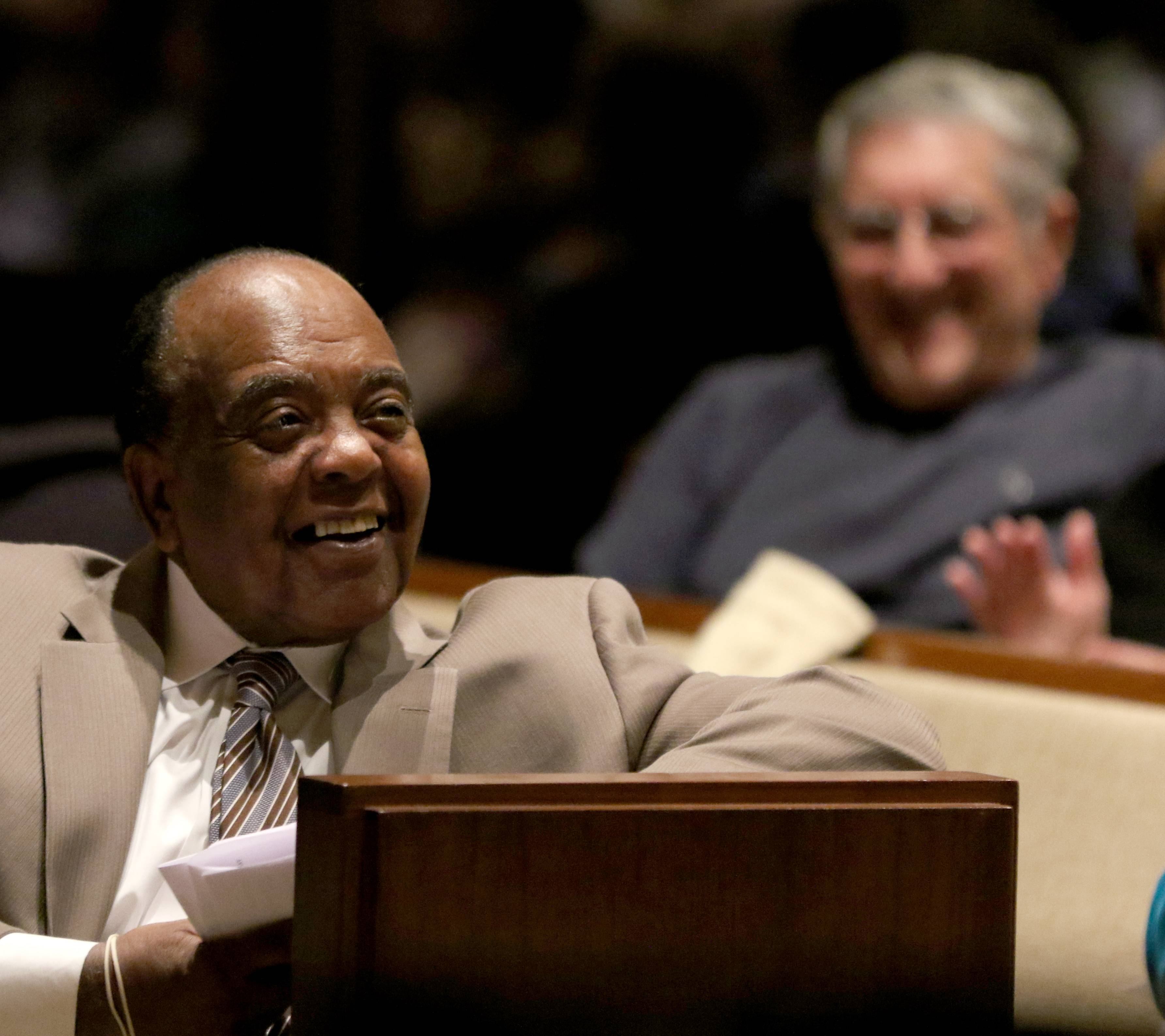 The Rev. Clyde Brooks listens Thursday to The Rev. Michael Pfleger's message at First United Methodist Church in Arlington Heights.