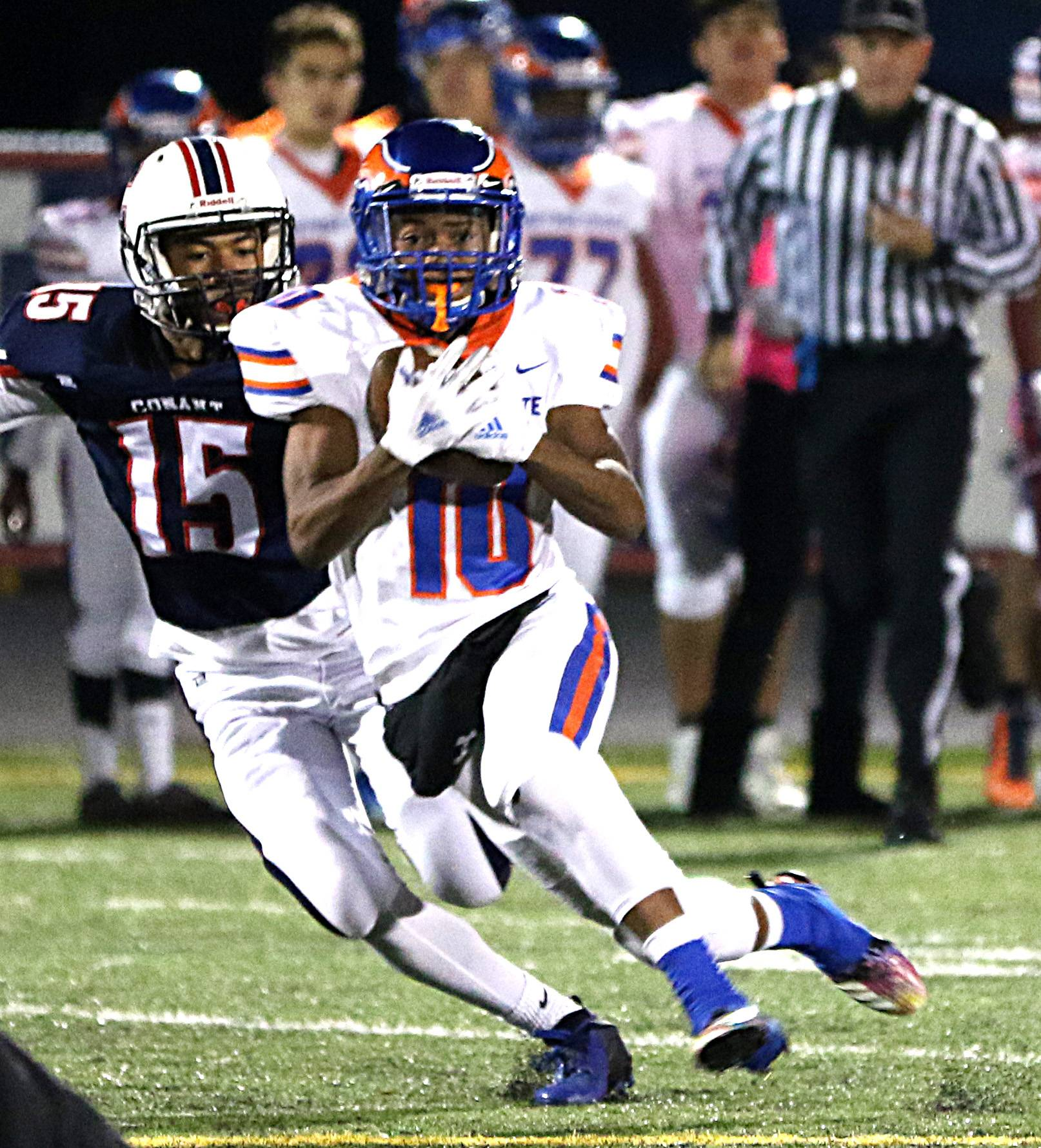 Hoffman Estates' Jashawn Johnson, front, slips past Conant's Ronald Williams.