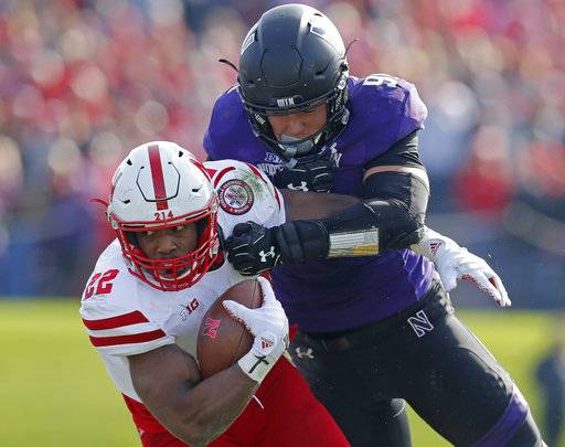 FILE - In this Saturday, Oct. 13, 2018, file photo, Nebraska's Devine Ozigbo, left, is tackled by Northwestern's Samdup Miller during the second half of an NCAA college football game in Evanston, Ill. If Nebraska needs any extra incentive to pick up its elusive first win Saturday, players who were on the field against Minnesota last year need only remember what happened in that game.