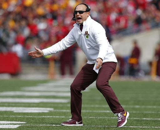 FILE - In this Saturday, Oct. 13, 2018, file photo, Minnesota head coach P.J. Fleck shouts to his team during the first half of an NCAA college football game against Ohio State in Columbus, Ohio. If Nebraska needs any extra incentive to pick up its elusive first win Saturday, players who were on the field against Minnesota last year need only remember what happened in that game.