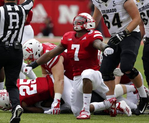 FILE - In this Sept. 8, 2018, file photo, Nebraska linebacker Mohamed Barry (7) celebrates a sack of Colorado quarterback Steven Montez (12) during the first half of an NCAA college football game in Lincoln, Neb. If Nebraska needs any extra incentive to pick up its elusive first win Saturday, players who were on the field against Minnesota last year need only remember what happened in that game.