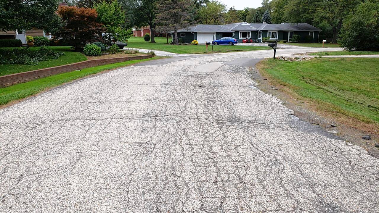 This is an example of a deteriorated street in Green Oaks. The village is seeking voter approval to create a municipal tax for road repairs.
