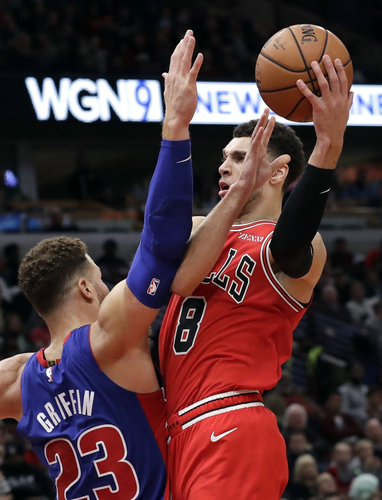 Chicago Bulls guard Zach LaVine, right, drives to the basket against Detroit Pistons forward Blake Griffin during the second half of an NBA basketball game Saturday, Oct. 20, 2018, in Chicago. The Pistons won 118-116. (AP Photo/Nam Y. Huh)
