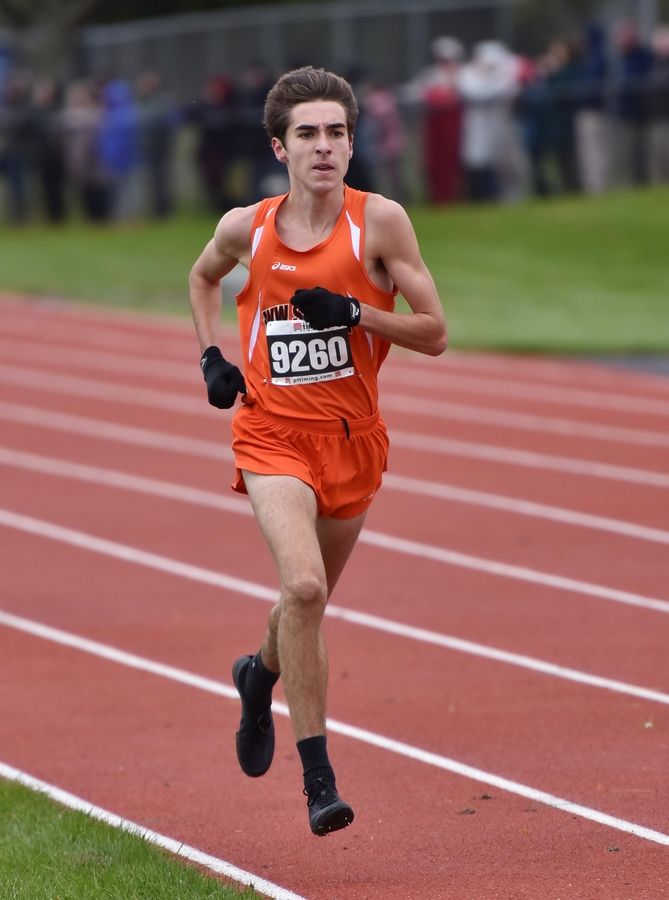 Scott Maison, of Wheaton Warrenville South High School finishes second at the boys Class 3A Lake Park cross country regional meet Saturday in Roselle.