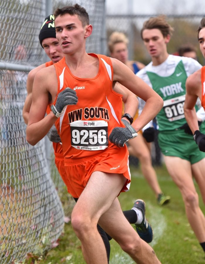 William Hauenstein, of Wheaton Warrenville South High School runs in the lead pack at the boys Class 3A Lake Park cross country regional meet Saturday in Roselle. He won the race.