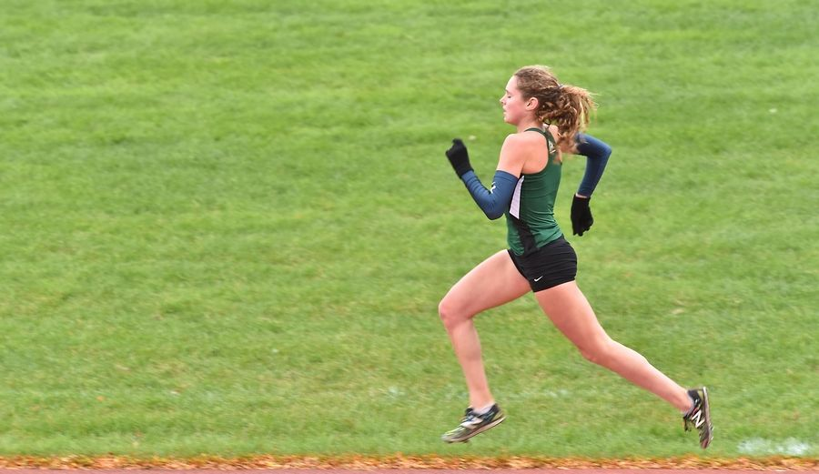 Katelynne Hart, of Glenbard West High School finishes the final stretch at the Class 3A Lake Park cross country regional meet Saturday in Roselle.