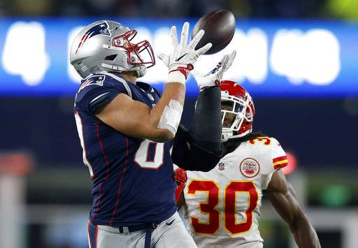FILE - In this Sunday, Oct. 14, 2018, file photo, New England Patriots tight end Rob Gronkowski, left, catches a pass in front of Kansas City Chiefs safety Josh Shaw (30) during the second half of an NFL football game in Foxborough, Mass. Gronkowski was the runaway choice this week as the NFL's top tight end by a panel of 10 football writers for The Associated Press. (AP Photo/Michael Dwyer, File)
