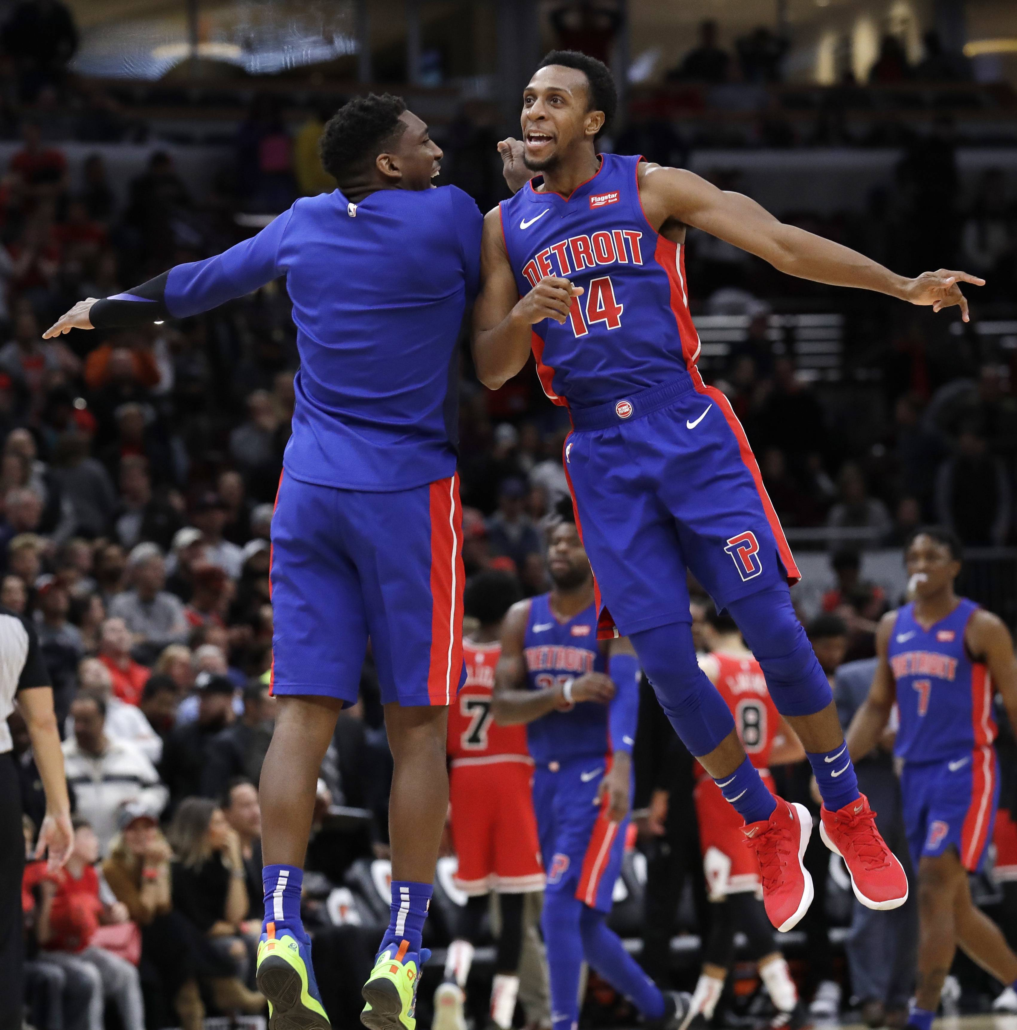 Detroit Pistons guard Ish Smith, right, celebrates with guard Langston Galloway after the Pistons defeated the Chicago Bulls 118-116 in an NBA basketball game Saturday, Oct. 20, 2018, in Chicago. (AP Photo/Nam Y. Huh)