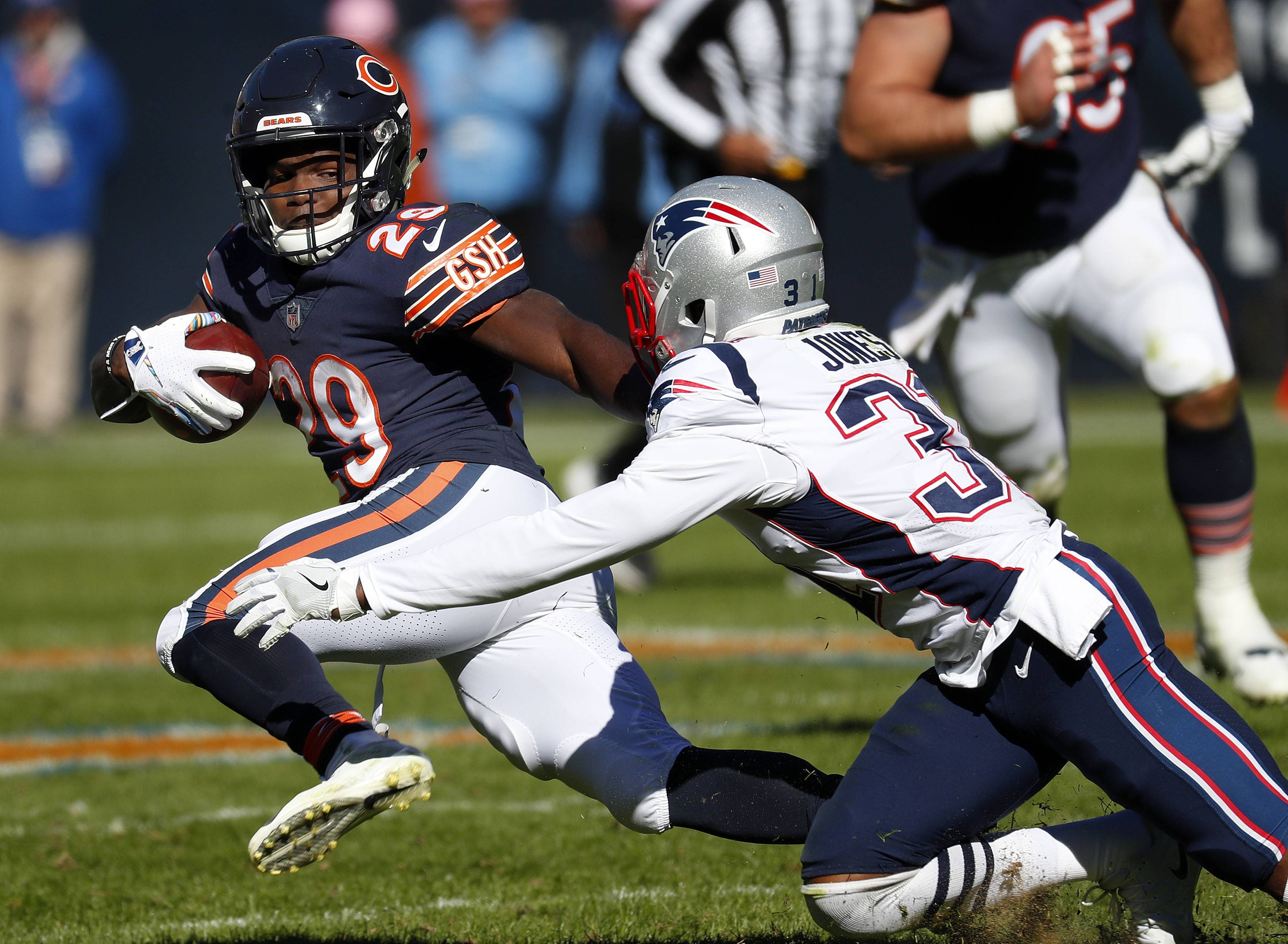 Chicago Bears running back Tarik Cohen tries to get around New England Patriots defensive back Jonathan Jones on Sunday at Soldier Field. Cohen just 14 yards on 6 attempts.
