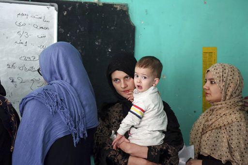 The Latest: Roadside bomb kills 11 in Afghanistan