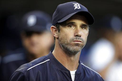 FILE - In this Sept. 22, 2017, file photo, Detroit Tigers manager Brad Ausmus appears in the dugout before a baseball game against the Minnesota Twins, in Detroit. Ausmus has been named the Los Angeles Angels' manager. General manager Billy Eppler on Sunday, Oct. 21, 2018, announced the hiring of Ausmus, who served as his special assistant last season. (AP Photo/Carlos Osorio, File)