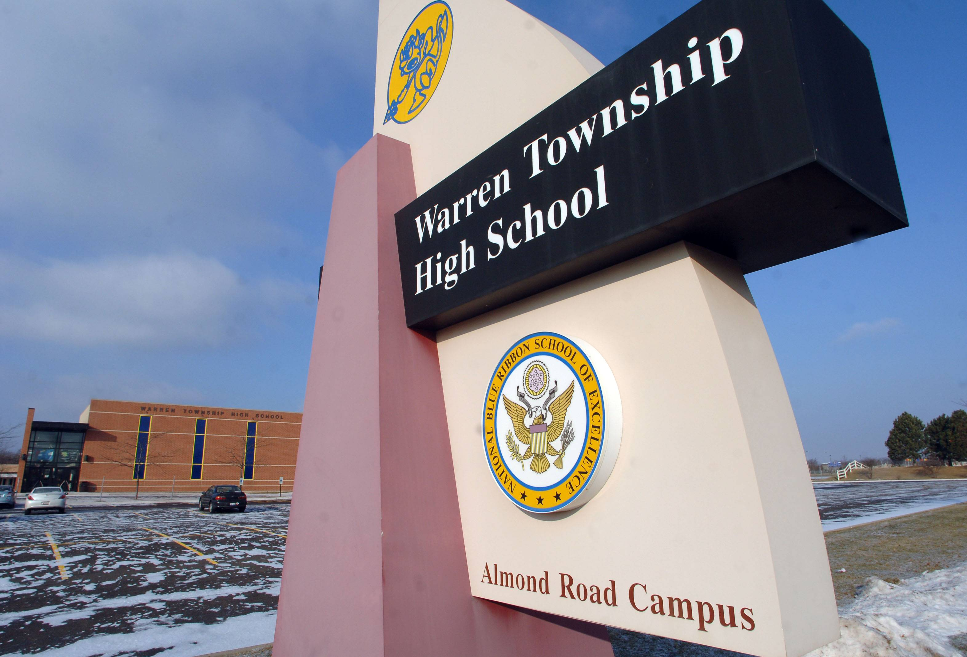 Warren Township High School District 121 will host a public hearing Tuesday night about borrowing $23 million to pay for projects, including a new roof for Warren Township High School's Almond Road campus.