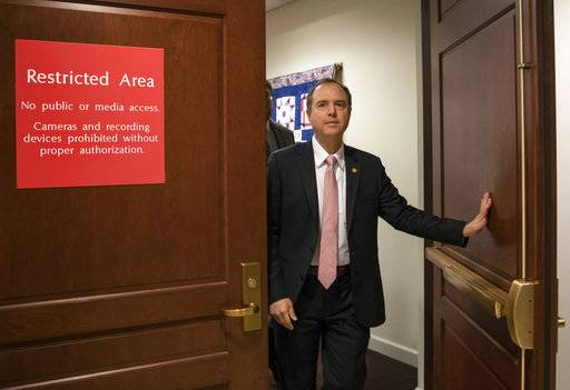 FILE - In this March 22, 2018 file photo, Rep. Adam Schiff, D-Calif., ranking member of the House Intelligence Committee, exits a secure area to speak to reporters, on Capitol Hill in Washington.  House Democrats are expected to re-open the investigation into Russian interference in the 2016 election if they win the majority in the November midterms, but they would have to be selective in what they investigate.