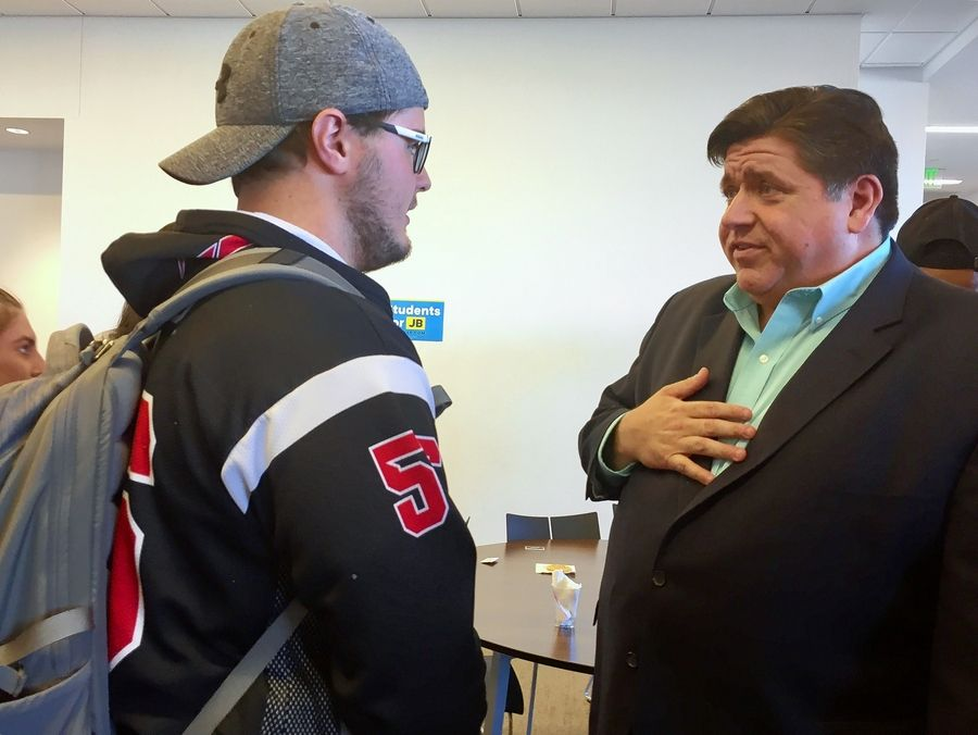 Democratic candidate for governor J.B. Pritzker talks issues with freshman Jacob Forbes at Benedictine University in Lisle Tuesday.