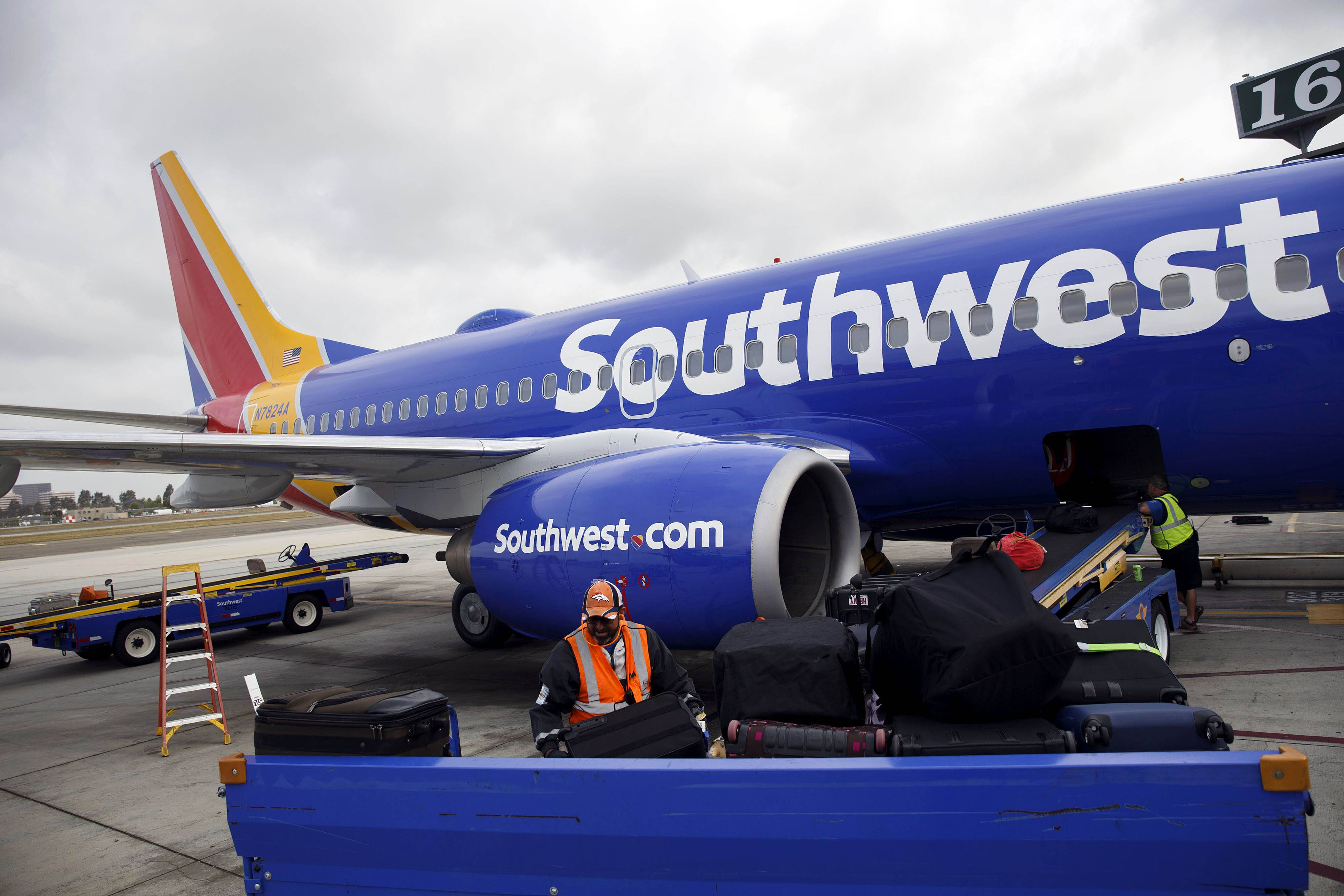 A ground operations employee loads baggage onto a Southwest Airlines Boeing 737.