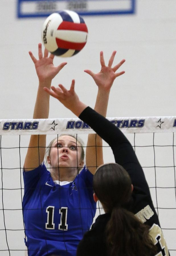 St. Charles North's Katherine Lanz blocks against Streamwood during regional play in varsity girls volleyball at St. Charles North Tuesday night.