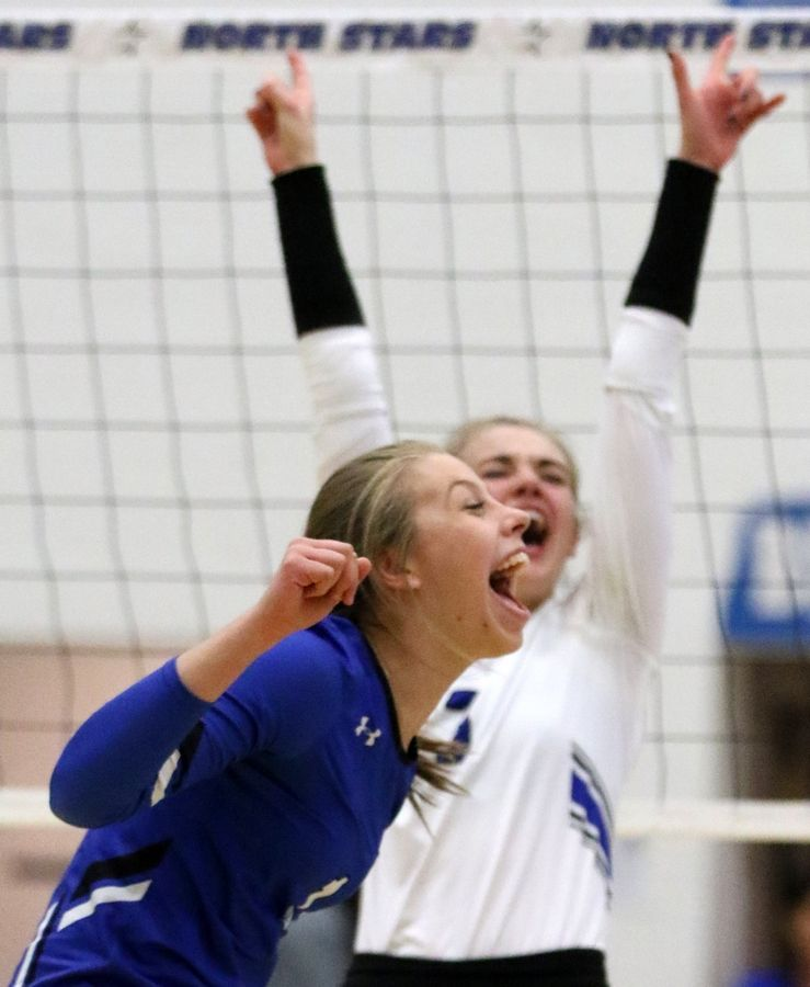 Geneva's Grace Hinchman, front, and Elizabeth Ford revel in a first-set victory over Batavia during regional play in varsity girls volleyball at St. Charles North Tuesday night.