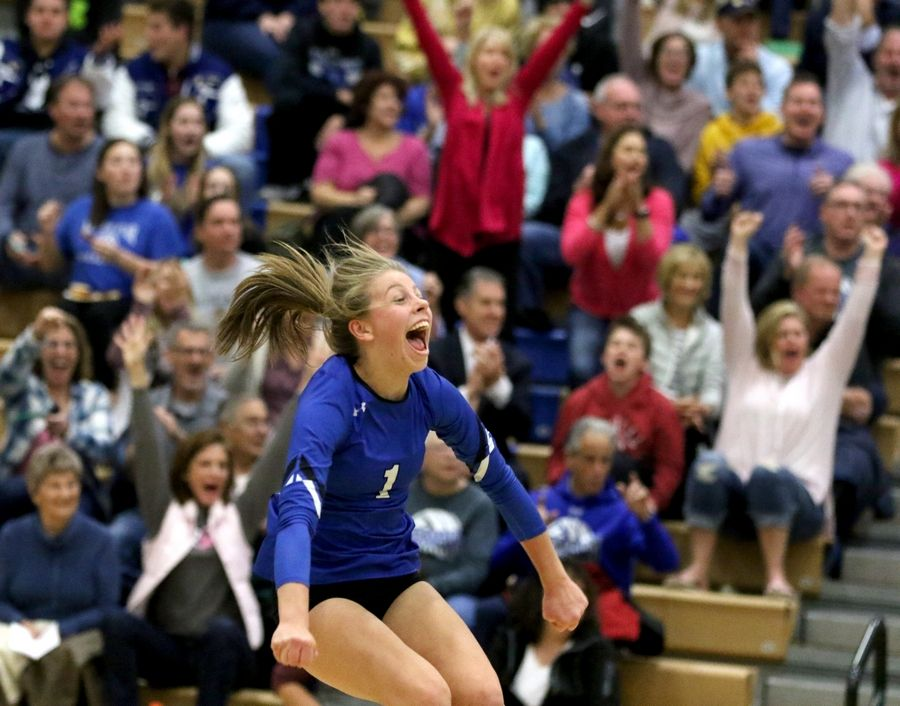 Geneva's Grace Hinchman celebrates a point over Batavia during regional play in varsity girls volleyball at St. Charles North Tuesday night.