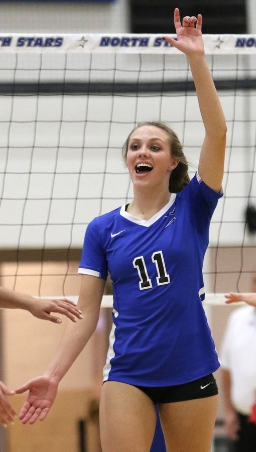St. Charles North's Katherine Lanz celebrates a first-set victory over Streamwood during regional play in varsity girls volleyball at St. Charles North Tuesday night.