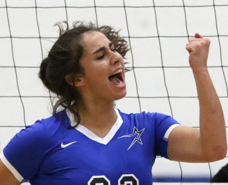 St. Charles North's Marissa Guajardo celebrates a point over Streamwood during regional play in varsity girls volleyball at St. Charles North Tuesday night.