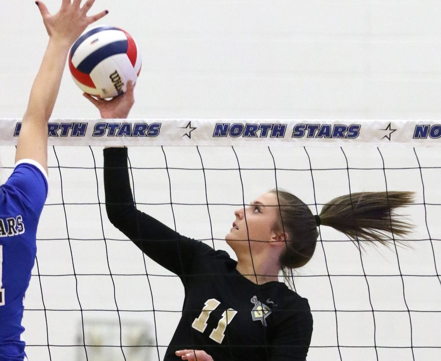 Streamwood's Vivian Sumoski sends the ball over the net against St. Charles North during regional play in varsity girls volleyball at St. Charles North Tuesday night.