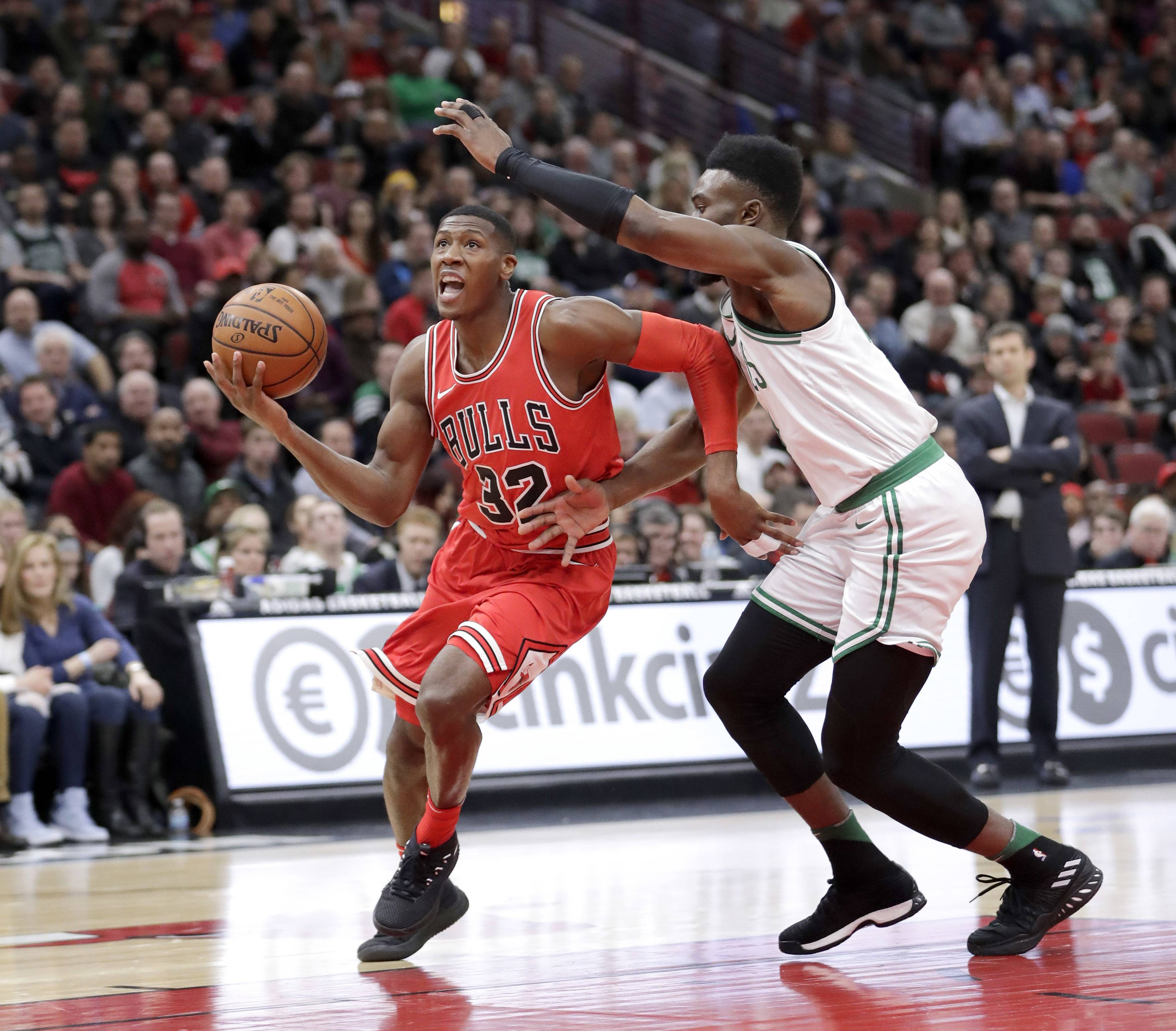 The Bulls' Kris Dunn will miss up to six weeks after injuring his knee Monday in Dallas, coach Fred Hoiberg said.