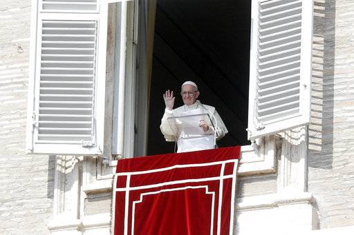Pope Francis waves to faithful at the end of the Angelus prayer he delivered in St. Peter's Square at the Vatican, Sunday, Oct. 21, 2018. (AP Photo/Gregorio Borgia)