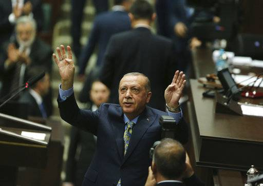 Turkey's President Recep Tayyip Erdogan waves as he arrives to address members of his ruling Justice and Development Party (AKP), in Ankara, Turkey, Tuesday, Oct. 23, 2018. Erdogan was expected to announce details of his country's investigation into the killing of Saudi writer Jamal Khashoggi, as skepticism intensified about Saudi Arabia's account that he died accidentally in its consulate in Istanbul.(AP Photo/Ali Unal)