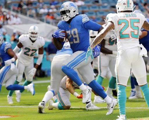 FILE - In this Oct. 21, 2018, file photo, Detroit Lions running back LeGarrette Blount (29) runs for a touchdown during the first half of an NFL football game against the Miami Dolphins, in Miami Gardens, Fla. The Dolphins need to patch up their leaky run defense, and fast. After allowing 248 yards rushing last week in a loss to Detroit, the Dolphins must regroup to face Houston on Thursday. (AP Photo/Lynne Sladky, File)