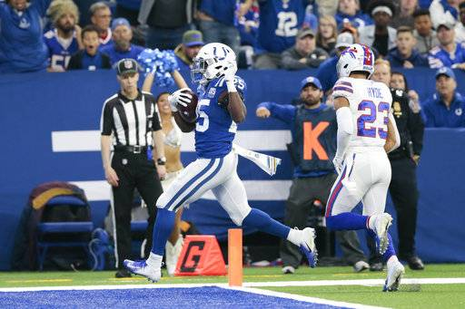 Indianapolis Colts running back Marlon Mack (25) scores a touchdown in front of Buffalo Bills strong safety Micah Hyde (23) during the first half of an NFL football game in Indianapolis, Sunday, Oct. 21, 2018. (AP Photo/AJ Mast)