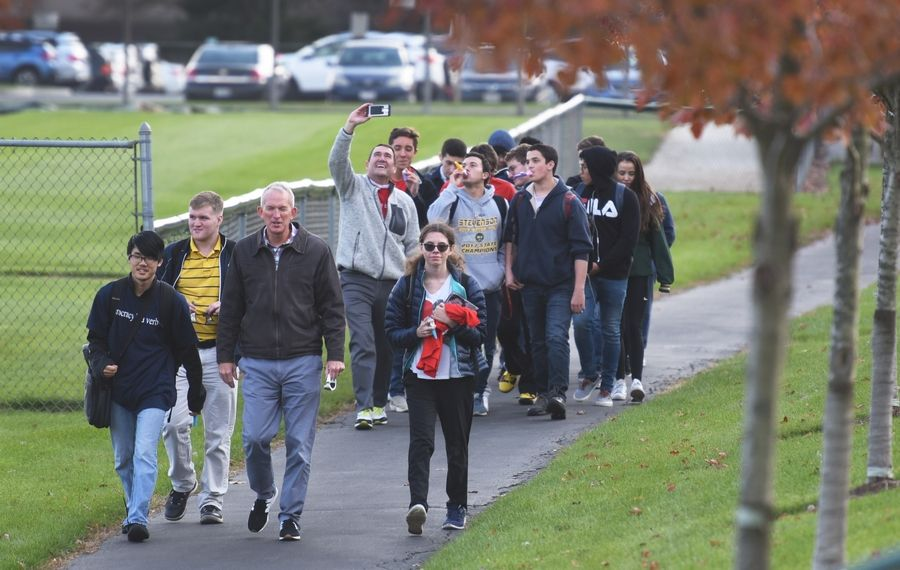 First-time voters and their supporters took part in an early voting event with the Stevenson High School Political Action Club on Wednesday. The group walked from the Lincolshire campus to the early voting location at William E. Peterson Park.