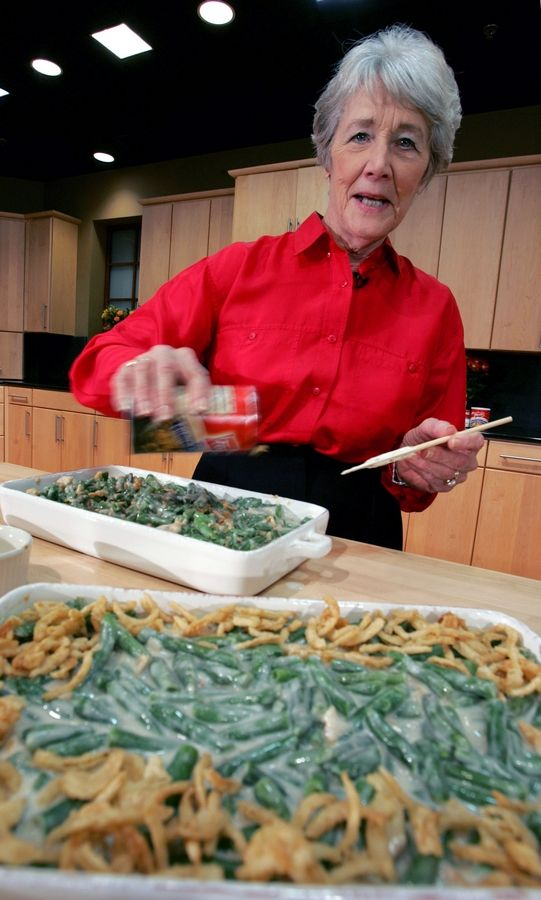 FILE -- In this Nov. 15, 2005 file photo, a Green Bean Cassorole sits in the foreground as Dorcas Reilly prepares another at the Campbell Soup Co. corporate kitchen in Camden, N.J. Reilly died on Monday, Oct. 15, 2018 and her family will celebrate her life on Saturday, Oct. 27 in the town where she lived, Haddonfield, N.J. Reilly was a Campbell Soup kitchen supervisor in 1955 when she combined green beans and cream of mushroom soup, topped with crunchy fried onions, for an Associated Press feature. It is the most popular recipe ever to come out of the corporate kitchen at Campbell Soup.