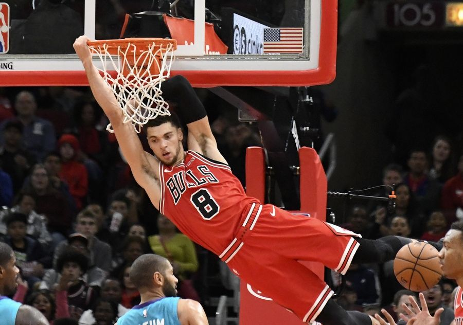4830ed7ae72 Chicago Bulls guard Zach LaVine (8) hangs on the rim after dunking the ball