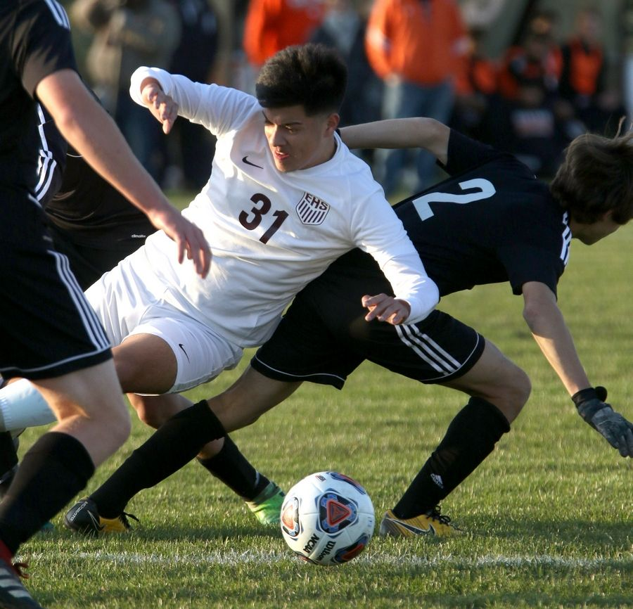 Elgin's Luisrey Ramos gets tangled up with a host of Crystal Lake Central players during sectional soccer at Hampshire High School on Wednesday.