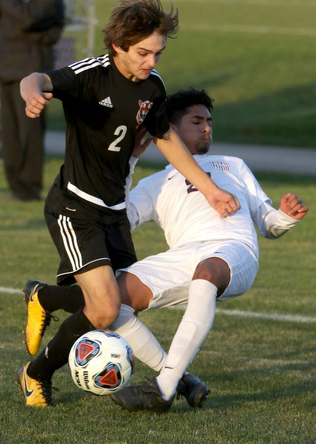 Elgin's Rafael Perez Jr., right, gets tangled up with Crystal Lake Central's Bryden Freund during sectional soccer at Hampshire High School on Wednesday.