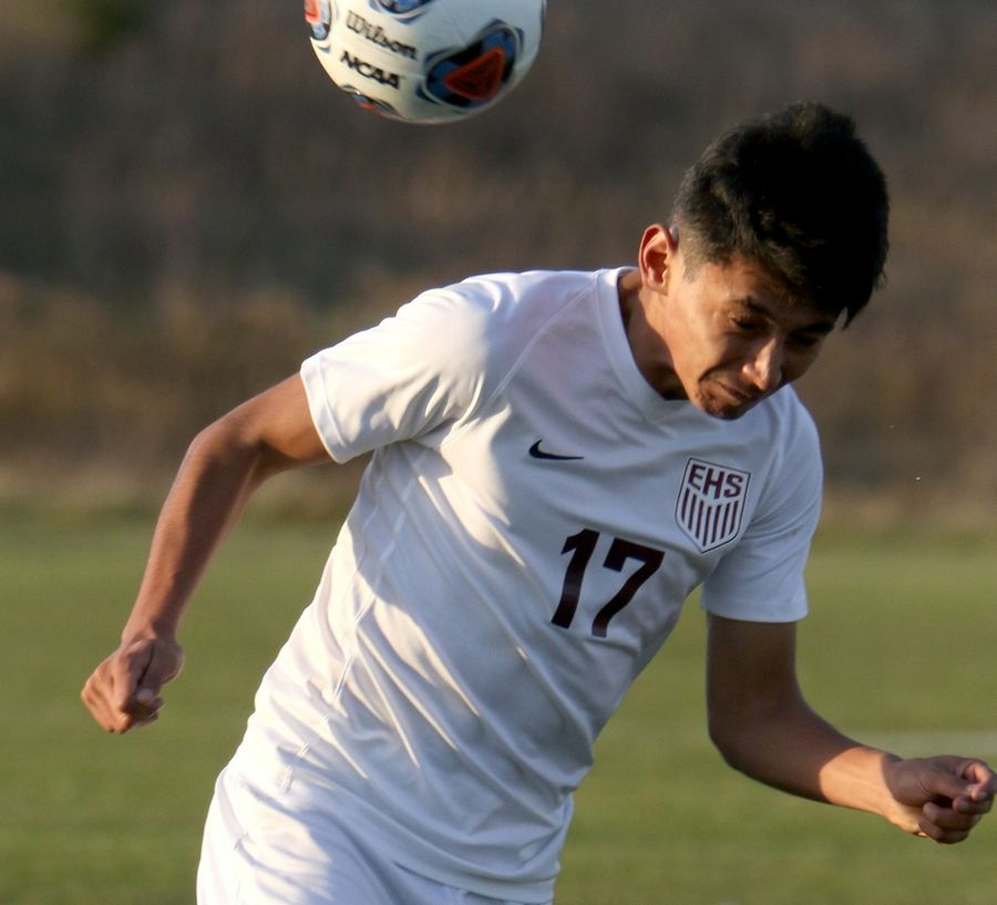 Elgin's Omar Lopez heads in a first-half goal against Crystal Lake Central Wednesday during sectional soccer at Hampshire.