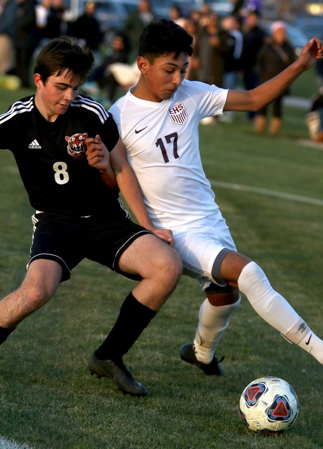 Elgin's Omar Lopez, right, gets tangled up with Crystal Lake Central's Luke Montford during sectional soccer at Hampshire High School on Wednesday.