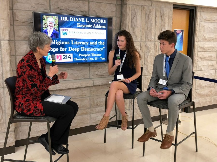 Diane Moore, who founded the Religious Literacy Project at Harvard's Divinity School, talks Friday with Prospect High School seniors Tia Sadlon and Conner Graver as part of a two-day conference on expanding religious literacy among high school students.