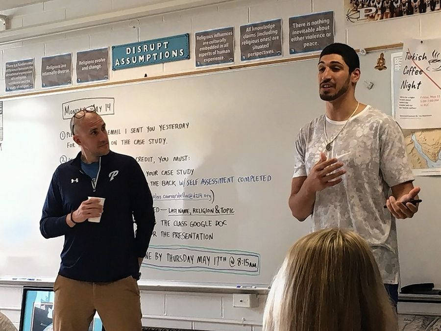 Professional basketball player Enes Kanter, right, addresses John Camardella's world religions class last spring at Prospect High School.