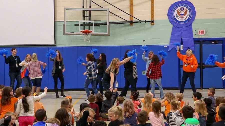 Teachers and students take part in a celebration of the 2018 National Blue Ribbon Award Friday at Evergreen School in Carol Stream.