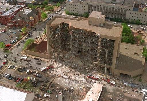 FILE - In this April 19, 1995, file photo, the north side of the Alfred Murrah Federal Building in Oklahoma City is missing after a vehicle bombing which killed 168 people. In 2018, the wave of mail-bombs targeting prominent Democrats, though yet to claim any victims, has angered and dismayed some of the people personally affected by past acts of political violence in the United States.  Looking only at the past 60 years, there have been scores of deadly incidents motivated by some sort of ideology.