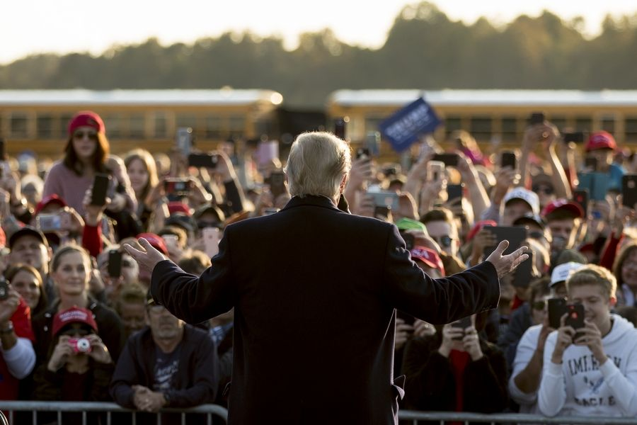President Donald Trump speaks to an overflow crowd at a rally at Southern Illinois Airport in Murphysboro, Ill., Saturday.