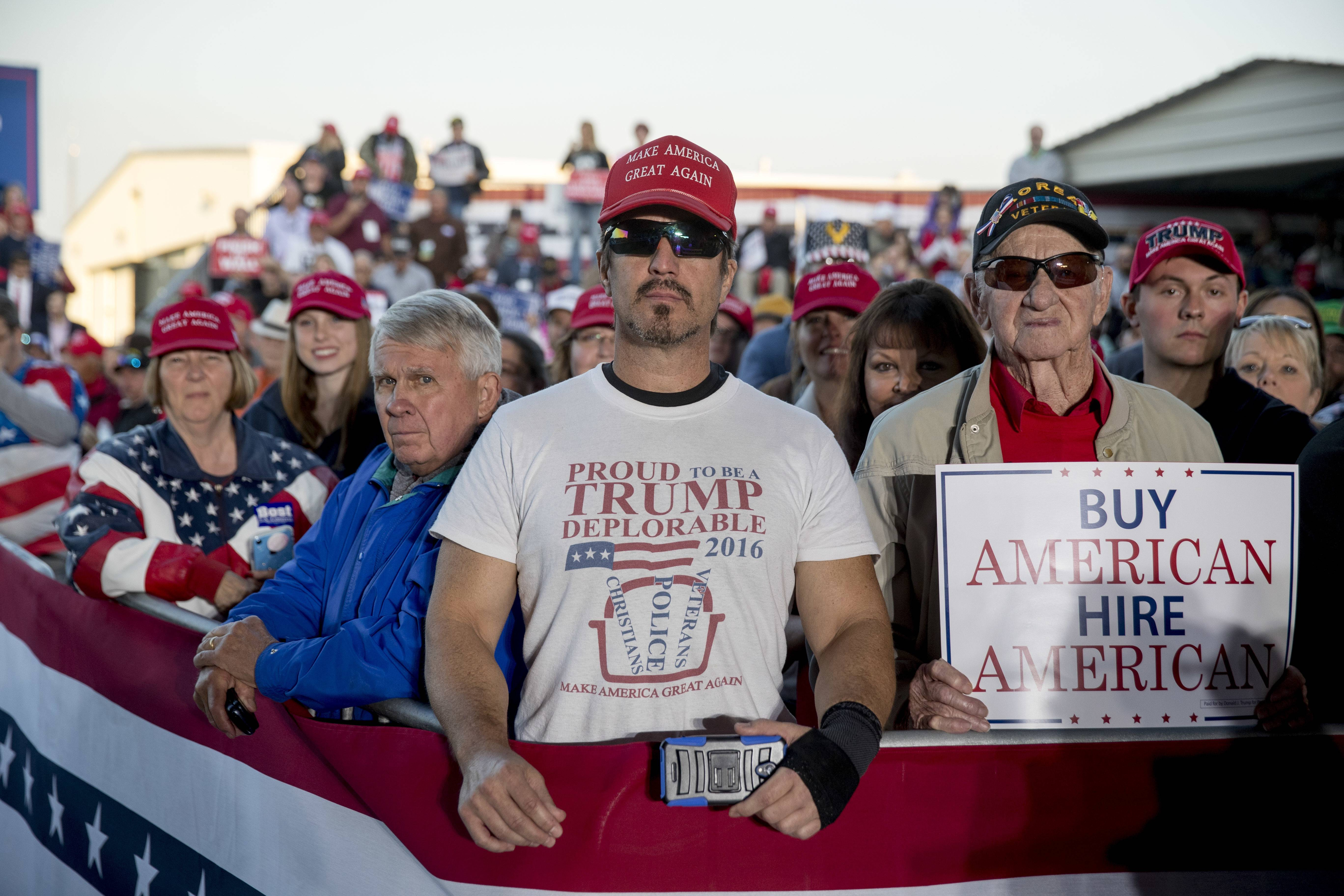"A member of the audience wears a shirt that reads ""Proud to Be A Trump Deplorable"" as President Donald Trump speaks at a rally at Southern Illinois Airport in Murphysboro, Ill., Saturday."