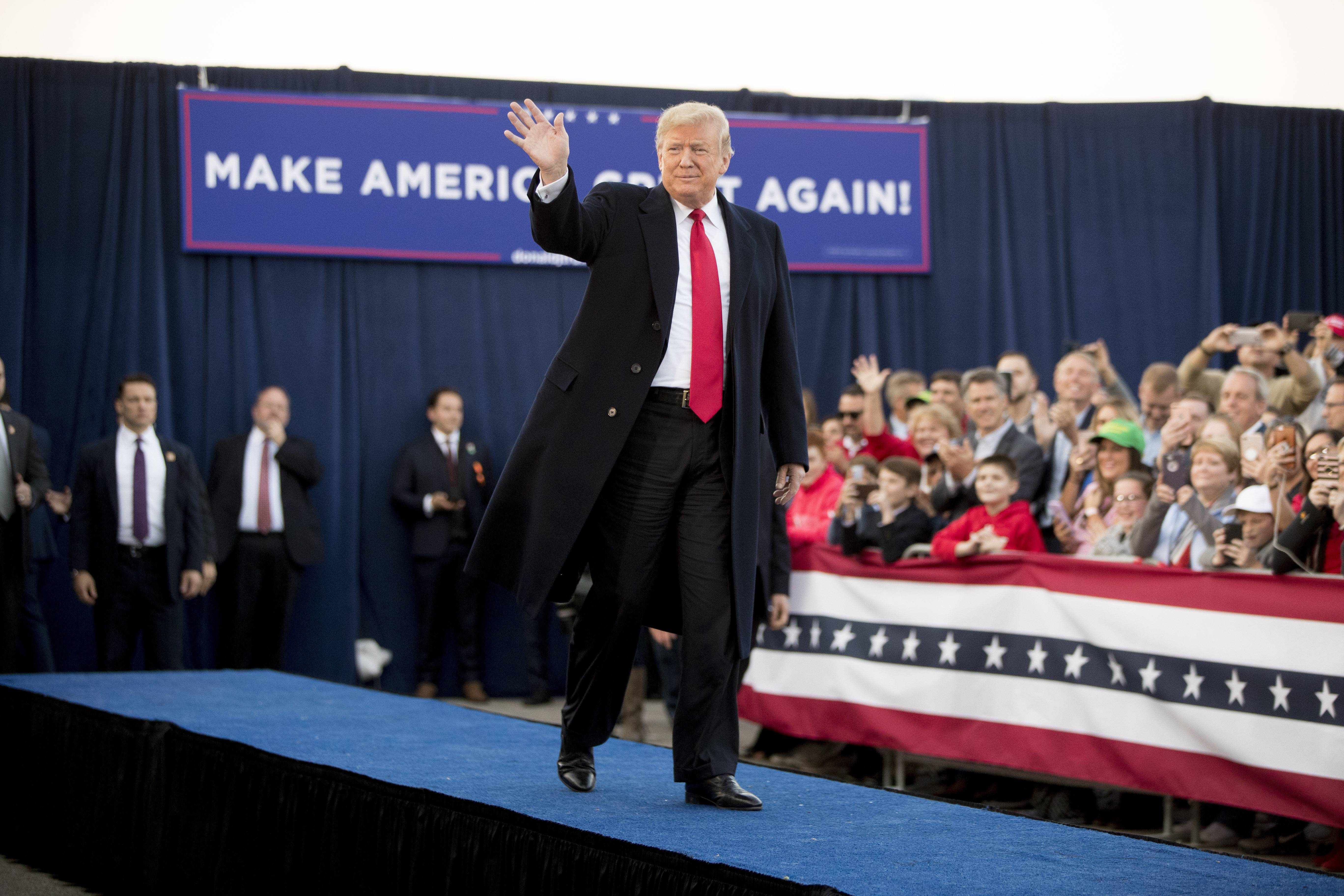 President Donald Trump arrives for a rally at Southern Illinois Airport in Murphysboro, Ill., Saturday.