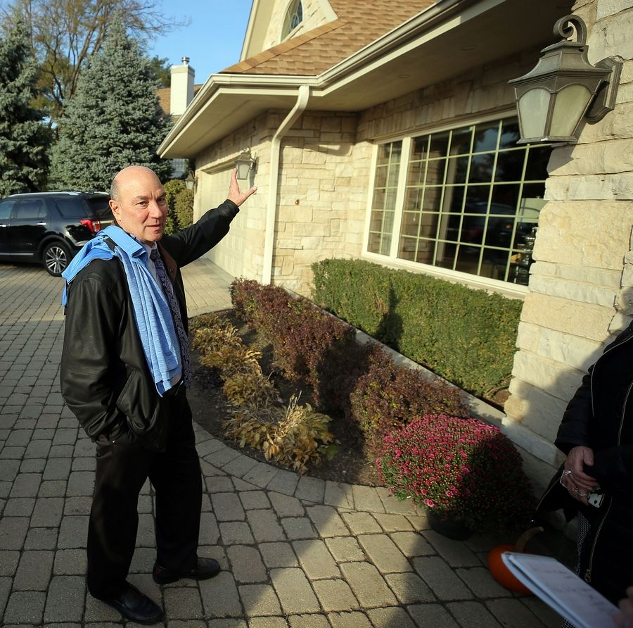 Paul DiFranco points to the area of his house in Park Ridge that caught on fire last Monday night. Disaster was averted when five Maine South High School students driving past after a hockey practice spotted the flames and alerted the DiFrancos and firefighters.