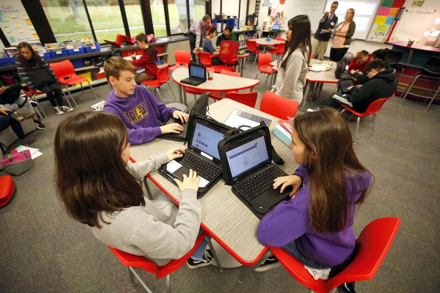 From left, Oliver Kocol, 12, Desirey Lopez, 13, and Melanie Garcia, 12,  test flexible seating at Carl Sandburg Junior High School in Rolling Meadows in a classroom. Palatine Township Elementary District 15 has a pilot program for the seating at two schools.