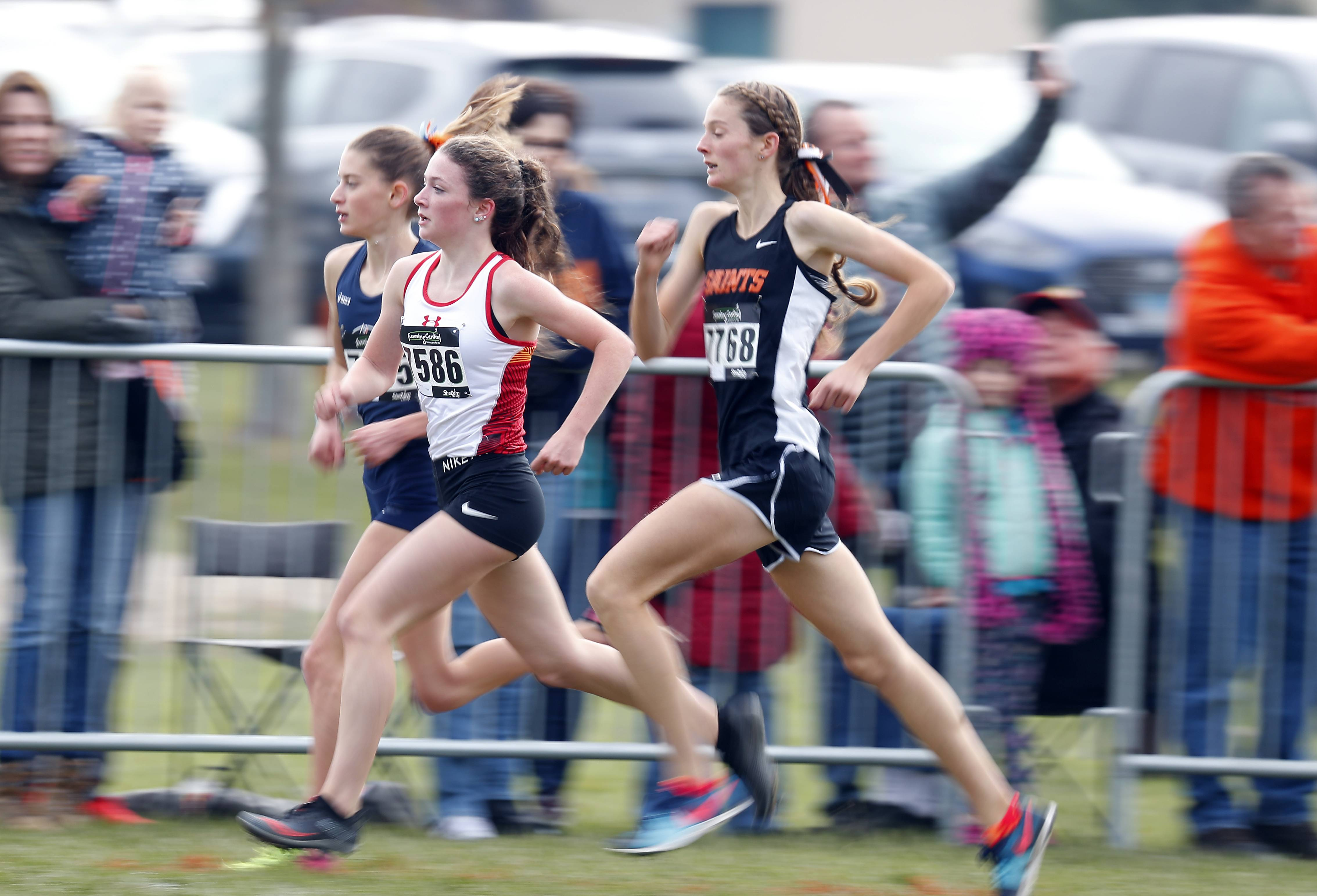 Katrina Schlenker of Batavia Saturday during the Waubonsie Valley cross country sectional in Aurora.