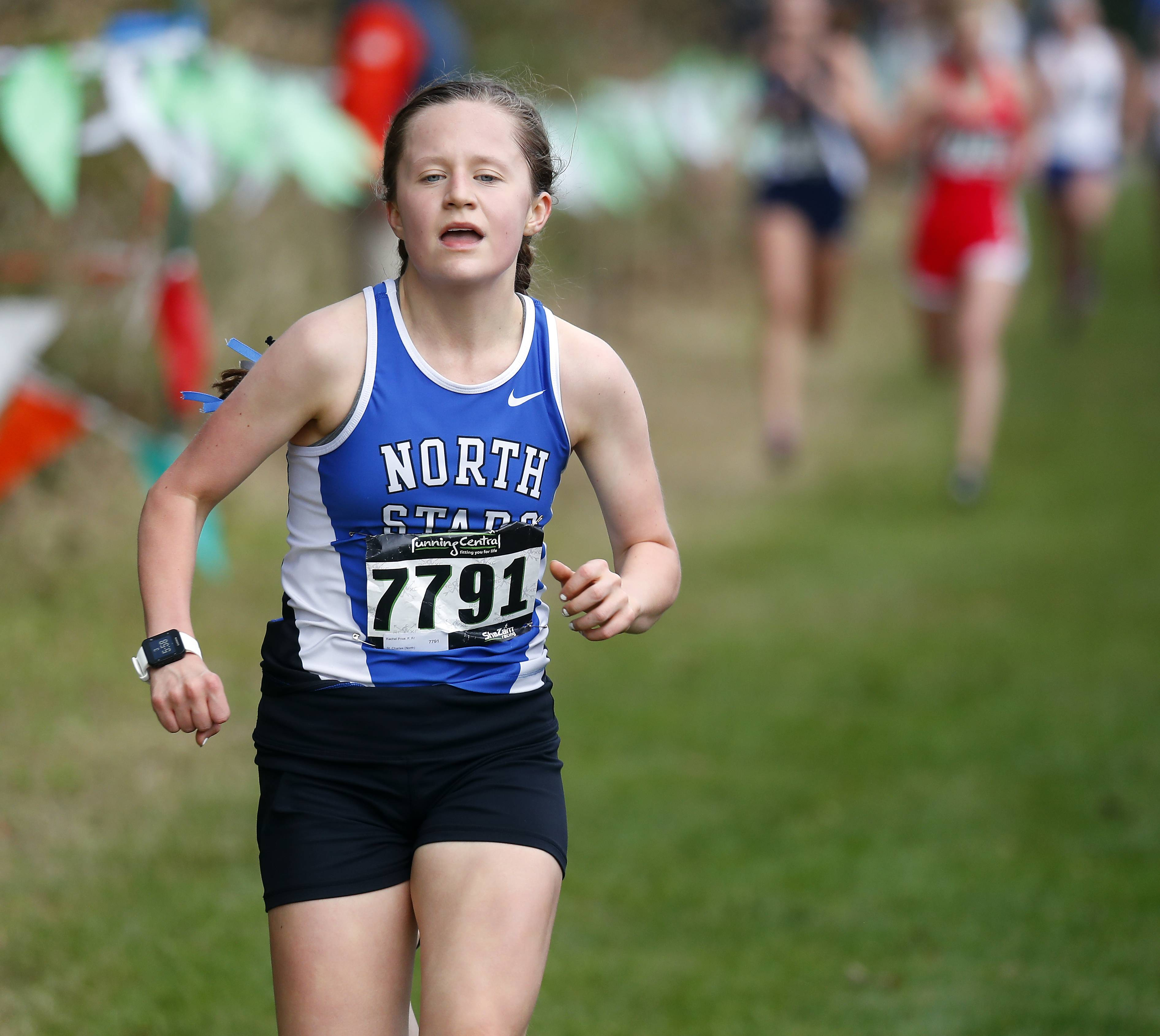Rachel Price, of St. Charles North Saturday during the Waubonsie Valley cross country sectional in Aurora.